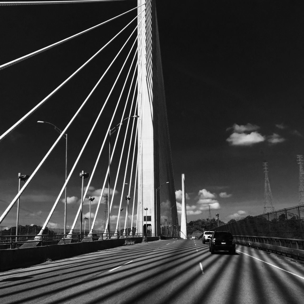Shadows Transportation Sky Car Built Structure Bridge - Man Made Structure Road Architecture Land Vehicle Connection The Way Forward City Building Exterior Suspension Bridge Outdoors No People Day Monochrome Monochromatic Art IPhoneography Trip Roadtrip