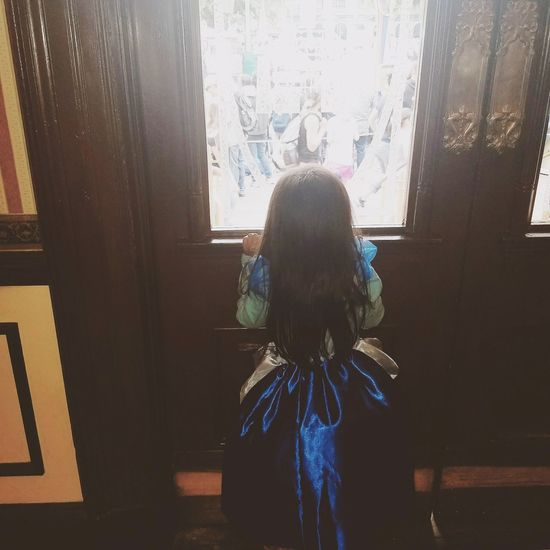 Indoors  Looking Through Window Window One Girl Only Standing Rear View Girls One Person Children Only Young Adult People Child Curtain Princess Disney Disneyland Princess Dress Disney Princess First Eyeem Photo