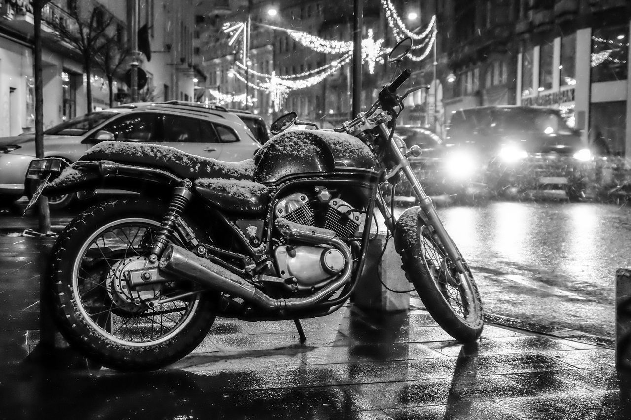 mode of transport, transportation, land vehicle, night, street, car, motorcycle, stationary, city, illuminated, outdoors, bicycle, scooter, no people