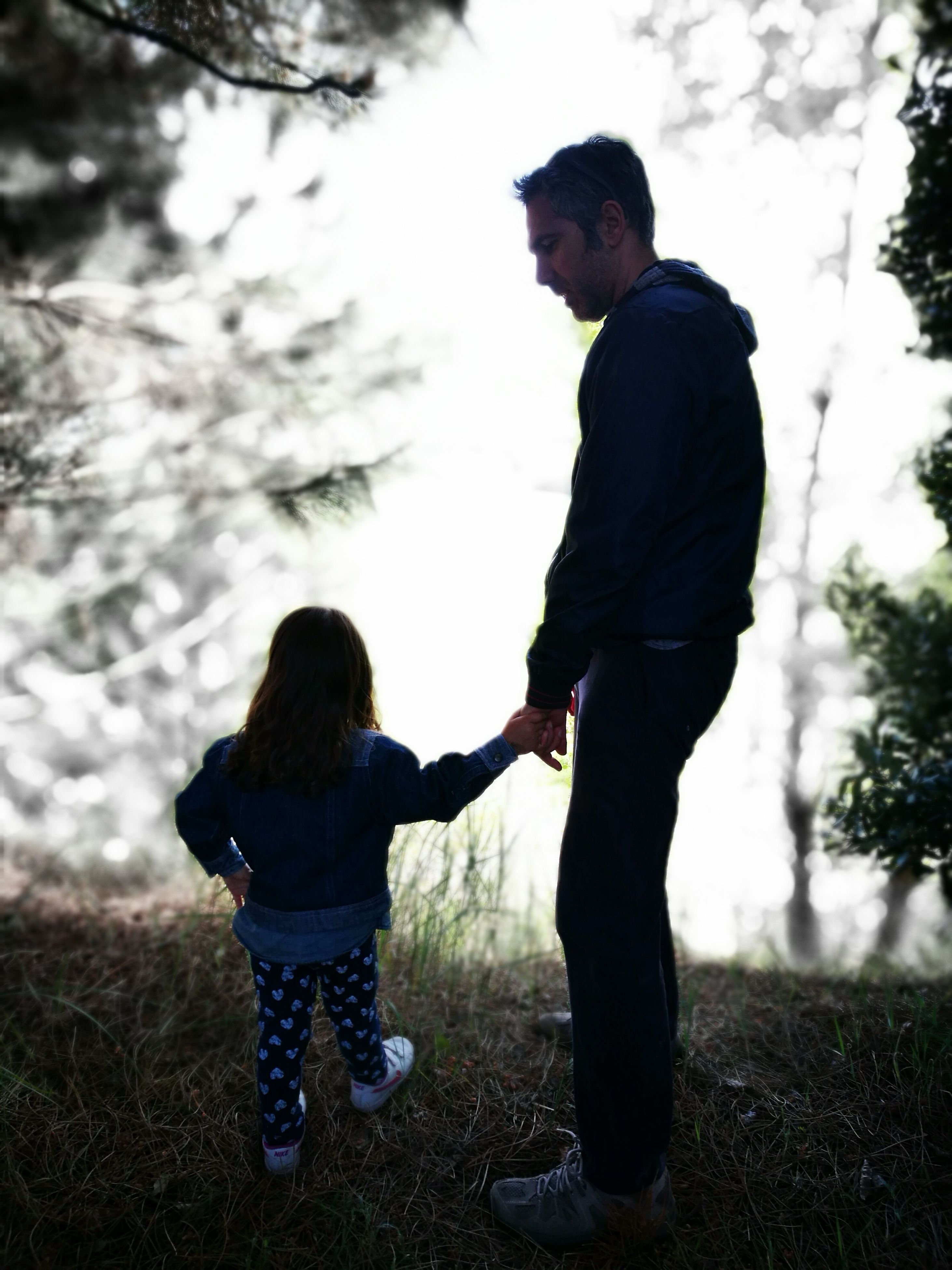 family with one child, togetherness, love, father, real people, full length, bonding, family, childhood, casual clothing, standing, leisure activity, lifestyles, men, son, outdoors, sky, grass, nature, day, young adult, tree, human hand, adult, people
