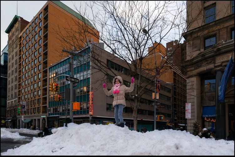 Queen of the Mountain - 1/24/16 Buildings In Background Cold Temperature Happy Little Lady Standing Atop Plowed Pile Of Snow Street Photography, NYC Winter