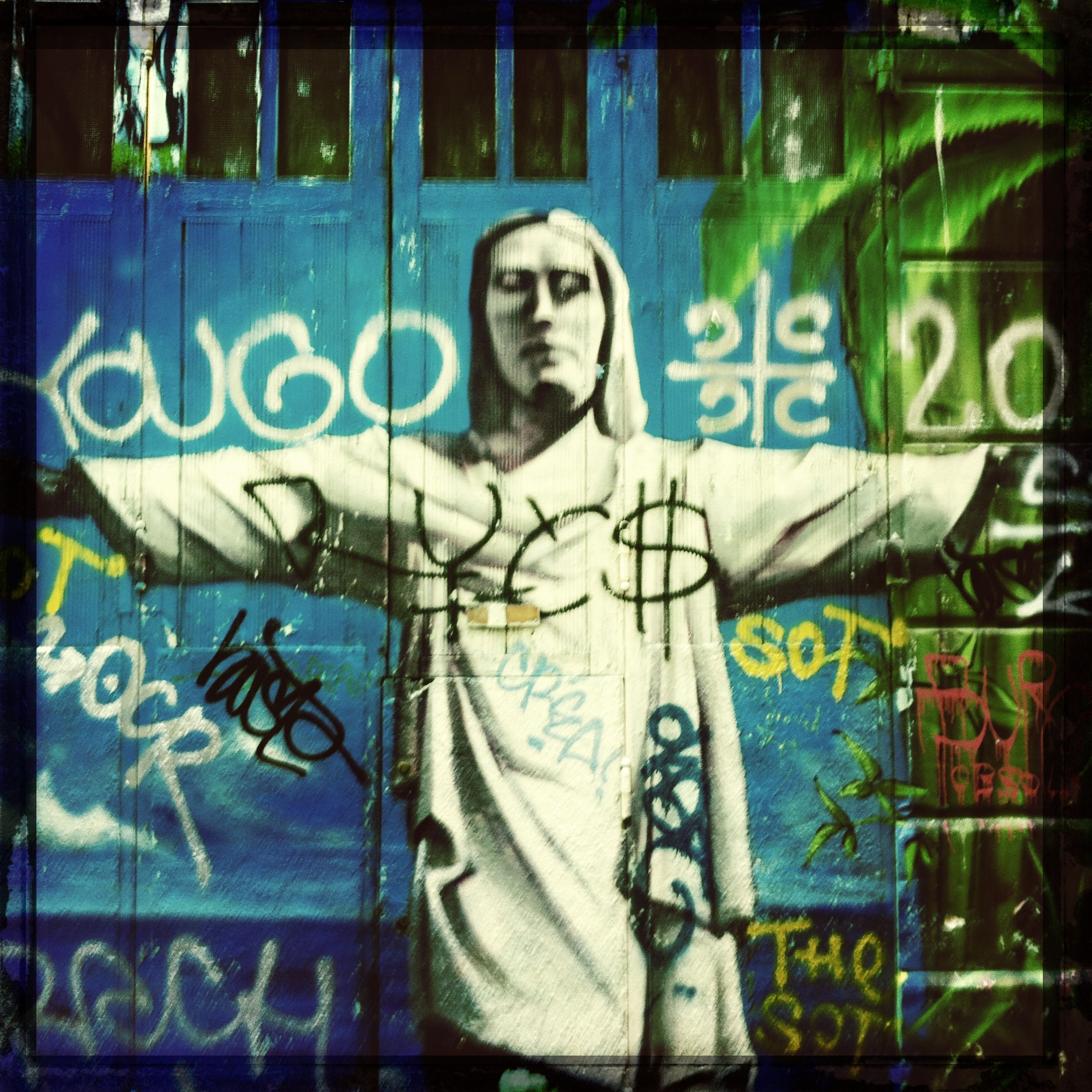 graffiti, art, text, creativity, art and craft, wall - building feature, western script, built structure, architecture, street art, communication, wall, human representation, indoors, multi colored, one person, vandalism, building exterior, painting, mural