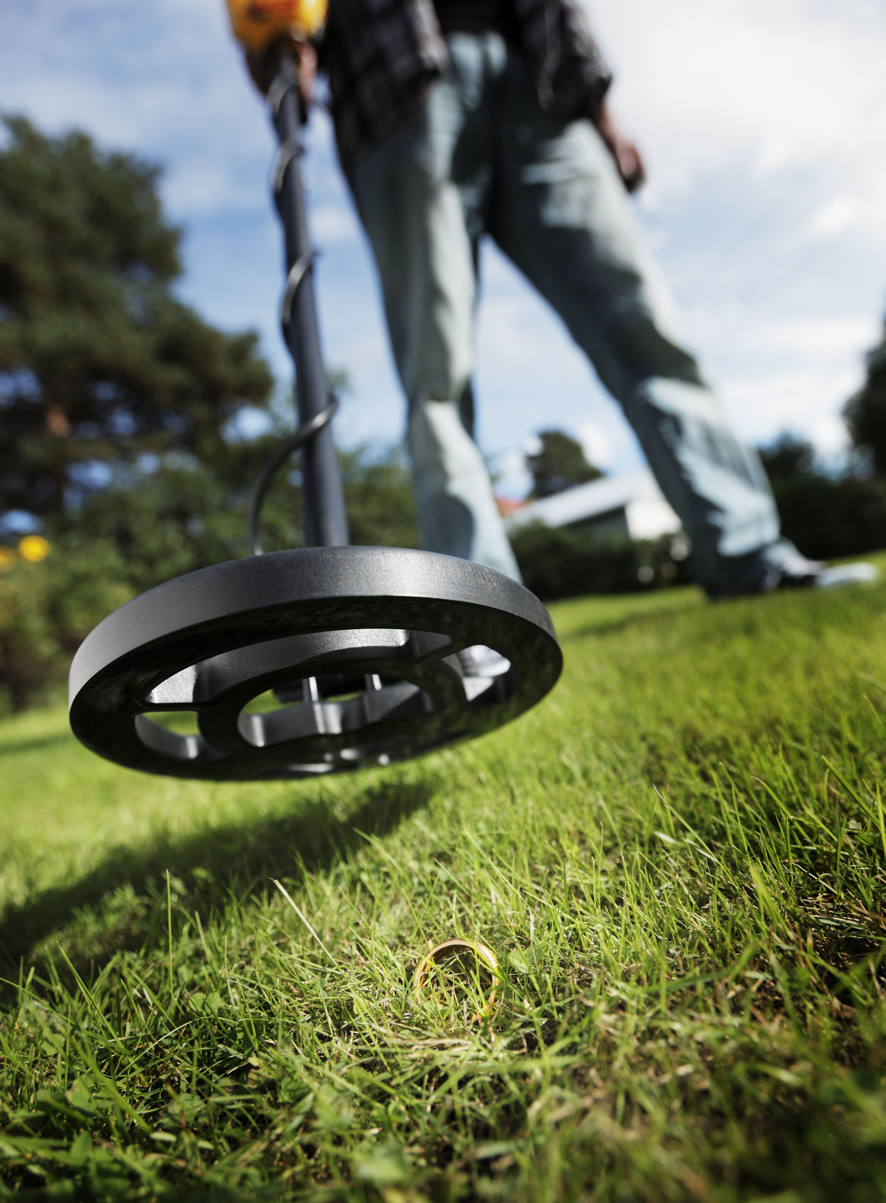 Man finding a gold ring in grass using a metal detector. Day Detector Finding New Frontiers Finds Found On The Roll Grass Grass Hidden Hobby Human Leg Jewelry Lawn Lost Low Angle View Metal Metal Detector One Person Outdoors Ring Search Searching Valuable