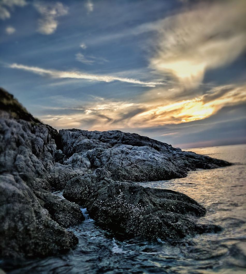 Sunset near the kcean is one of the best things to see with eyes...capturing made it better Sunset Water Sky Beauty In Nature Horizon Over Water Cloud - Sky Sea Nature Beach Rock - Object No People Outdoors Vacations Tranquility Wave Day Close-up UnderSea