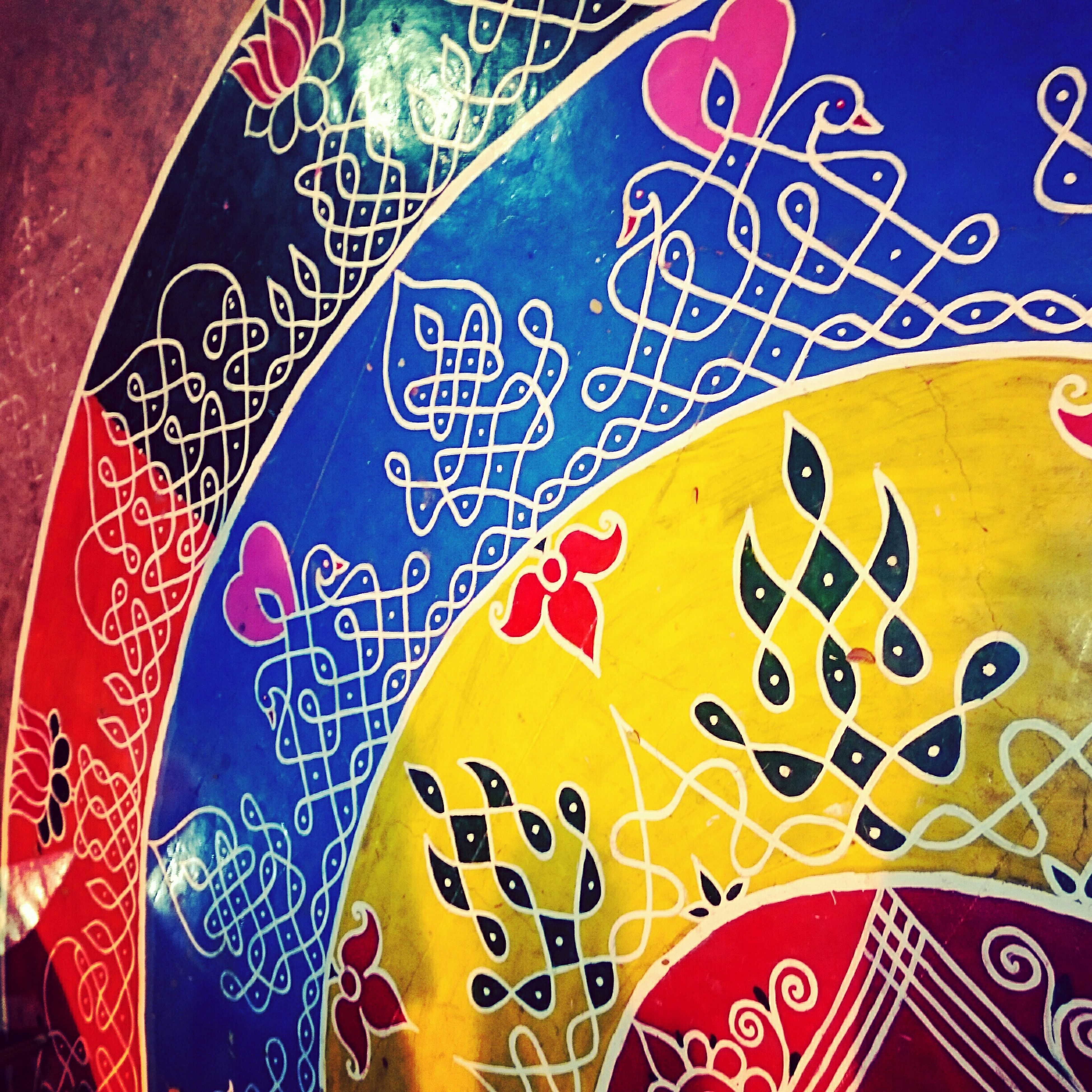 art and craft, creativity, art, text, communication, indoors, western script, multi colored, design, pattern, close-up, circle, graffiti, floral pattern, human representation, wall - building feature, animal representation, shape, non-western script, no people