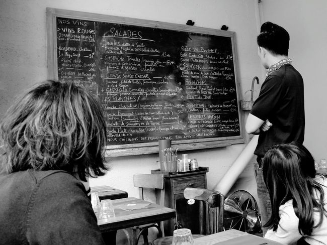 Deciding what to eat... People Together Lunch Time! Family Restaurant People Photography From My Point Of View Capture The Moment Seeing The Sights Black And White Black & White Monochrome Showcase July Wanderlust Vacation
