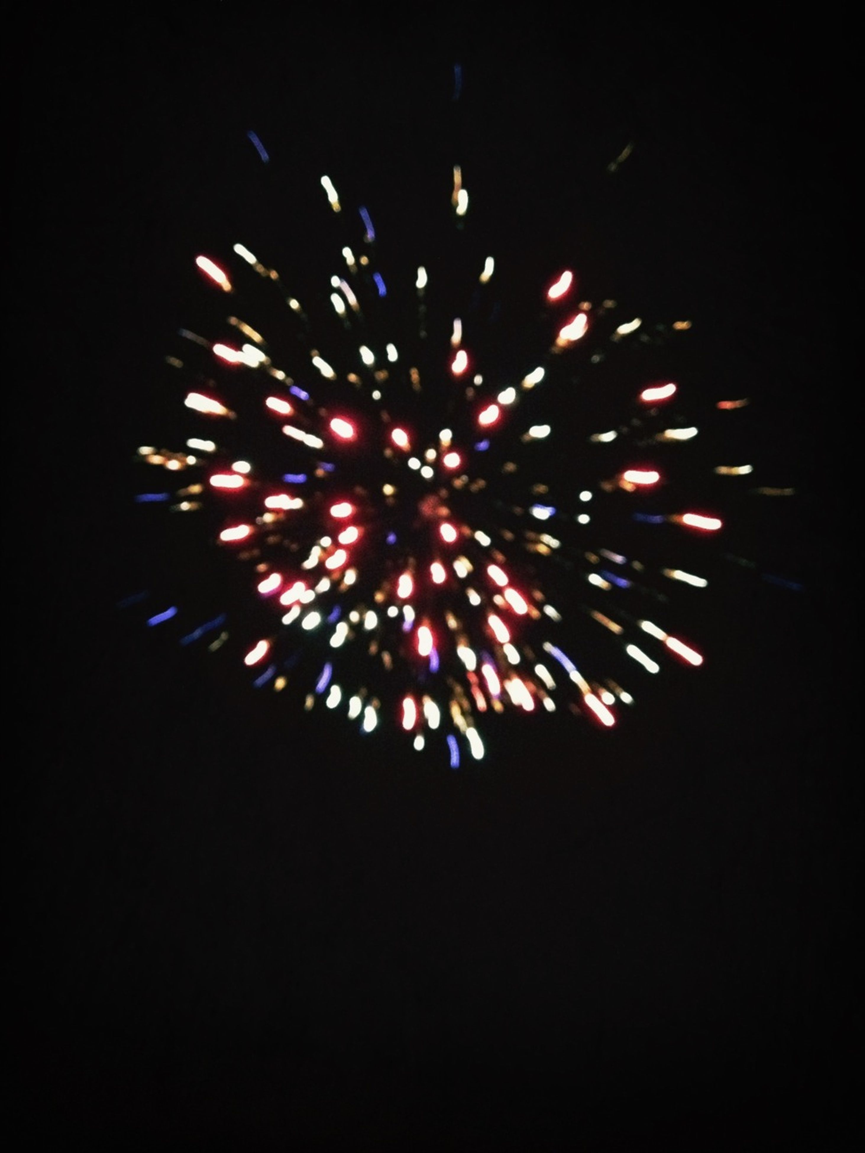 illuminated, night, celebration, firework display, arts culture and entertainment, exploding, low angle view, glowing, event, firework - man made object, long exposure, motion, multi colored, sky, celebration event, entertainment, firework, sparks, lighting equipment, decoration