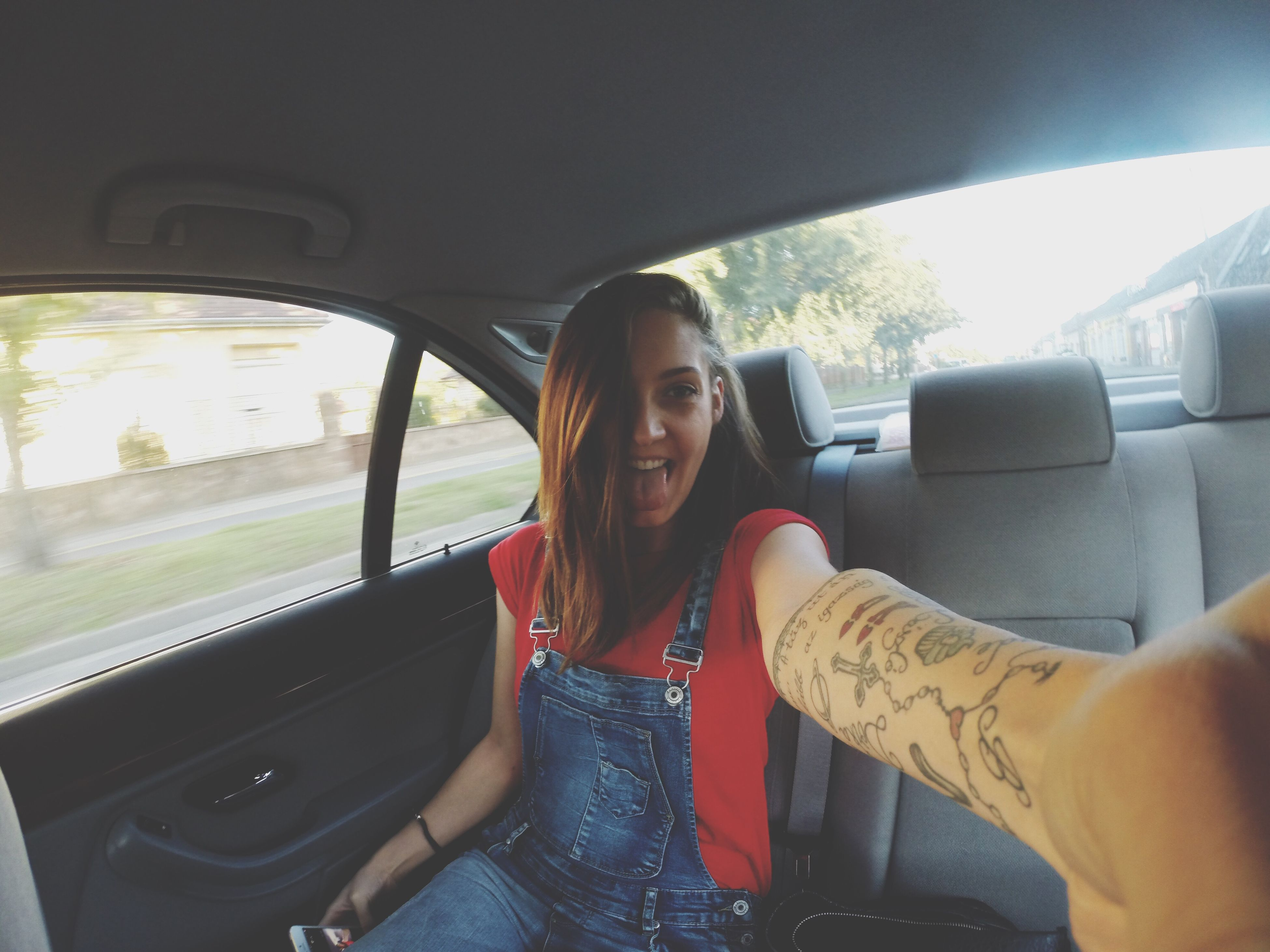 transportation, mode of transport, car, land vehicle, lifestyles, young adult, leisure activity, vehicle interior, young women, car interior, travel, sitting, person, sunglasses, window, casual clothing, portrait, looking at camera