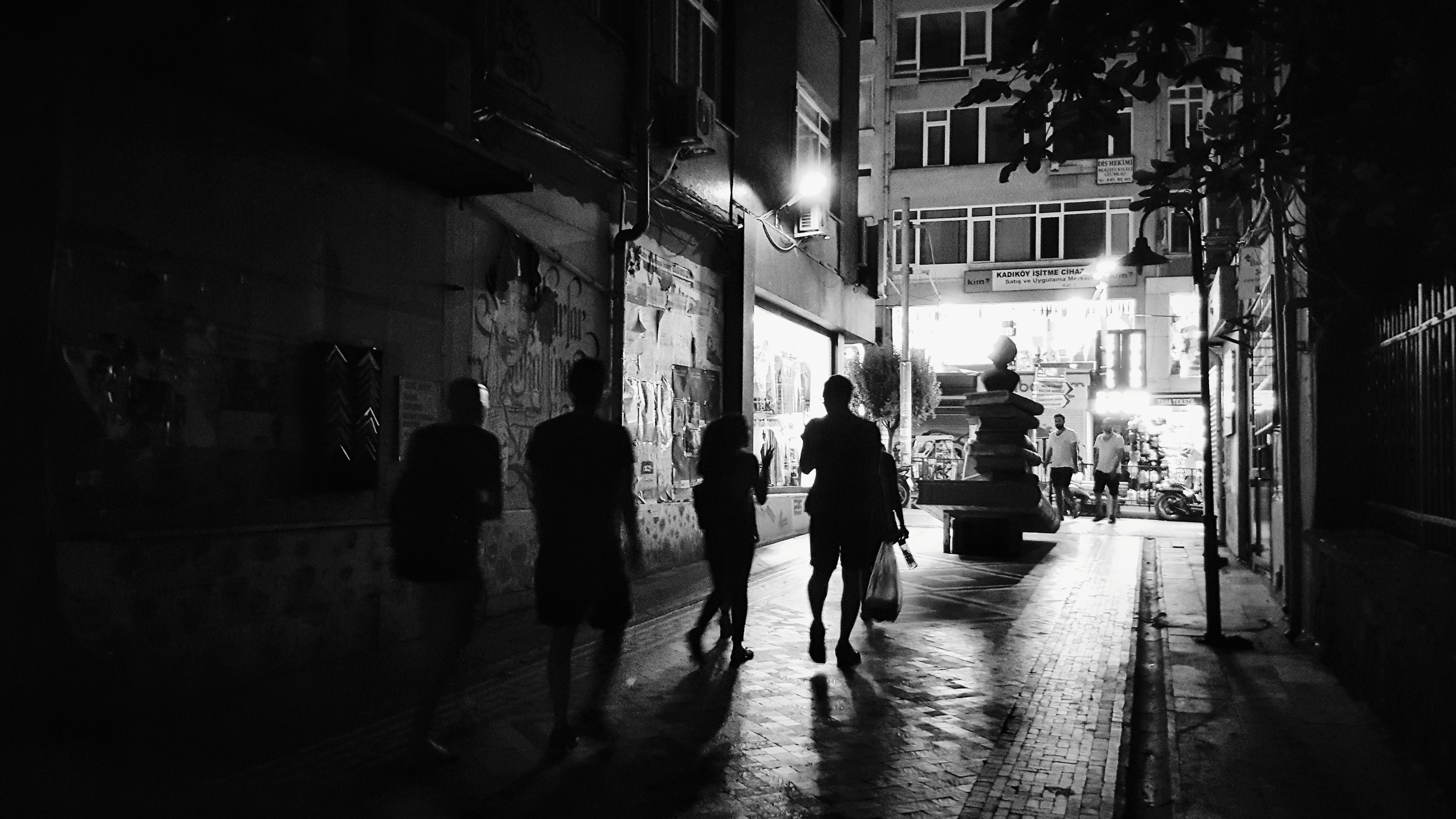 architecture, built structure, building exterior, walking, night, rear view, city, illuminated, street, city life, men, real people, women, full length, outdoors, adult, people