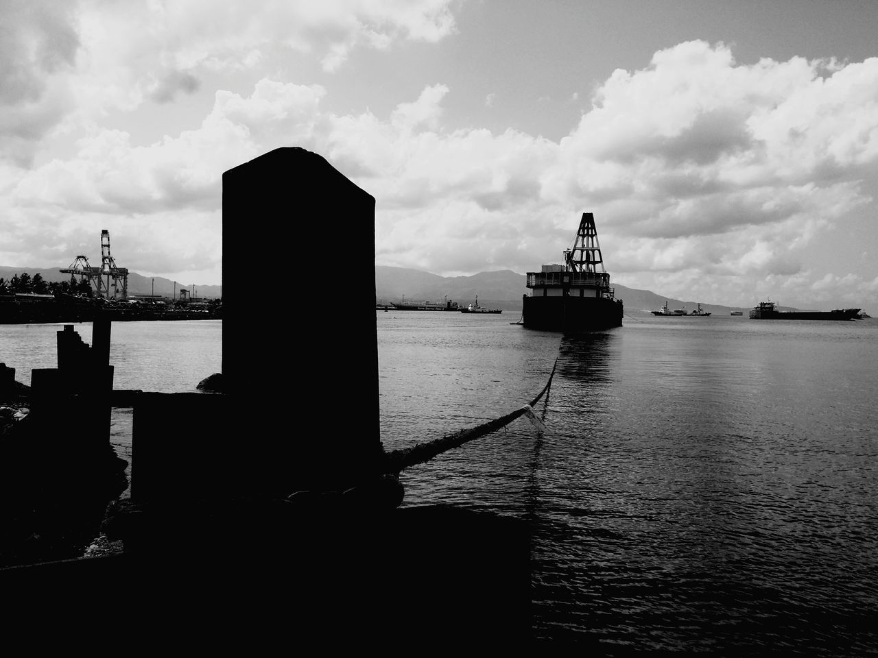 (Like a ) Ship on a Leash, one cannot reach the farthest reaches of the ocean when it is tied to land. Ship Sea Black And White Photography Dramatic Black And White Freedom Leash Constrained Batangas, Philippines Eyeem Philippines Feeling Down Fine Art Photography