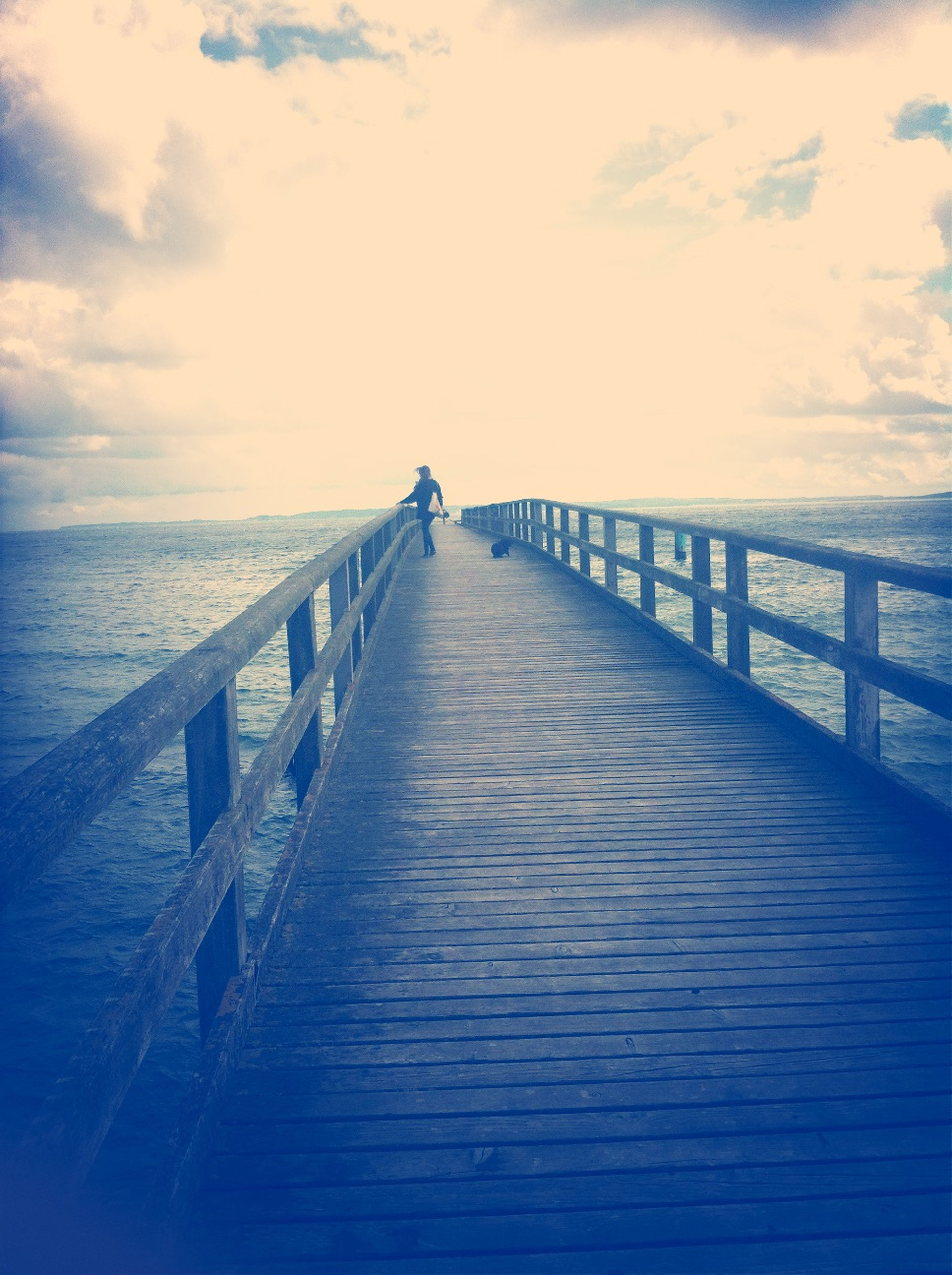 sea, water, pier, the way forward, sky, horizon over water, tranquil scene, tranquility, diminishing perspective, scenics, railing, long, nature, beauty in nature, wood - material, blue, jetty, cloud - sky, cloud, idyllic