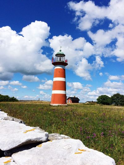 Leuchtturm, Gotland, Schweden Lighthouse Guidance Direction Protection Architecture Built Structure Safety Sky Tower Security Building Exterior Blue Field Cloud Cloud - Sky Outdoors Nature Day Rural Scene Cloudy