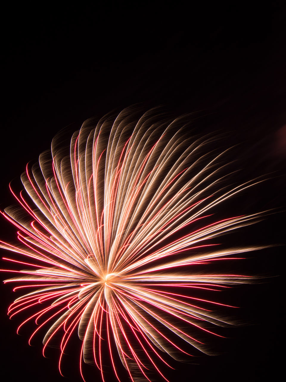 exploding, firework display, firework - man made object, arts culture and entertainment, night, long exposure, blurred motion, black background, celebration, event, motion, sky, illuminated, no people, low angle view, firework, multi colored, outdoors