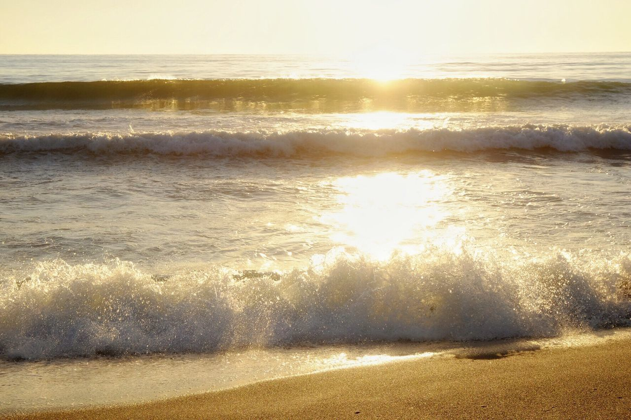 sea, sunlight, nature, water, beach, wave, beauty in nature, sunset, shore, sun, scenics, outdoors, tranquility, reflection, no people, tranquil scene, sand, horizon over water, sky, day