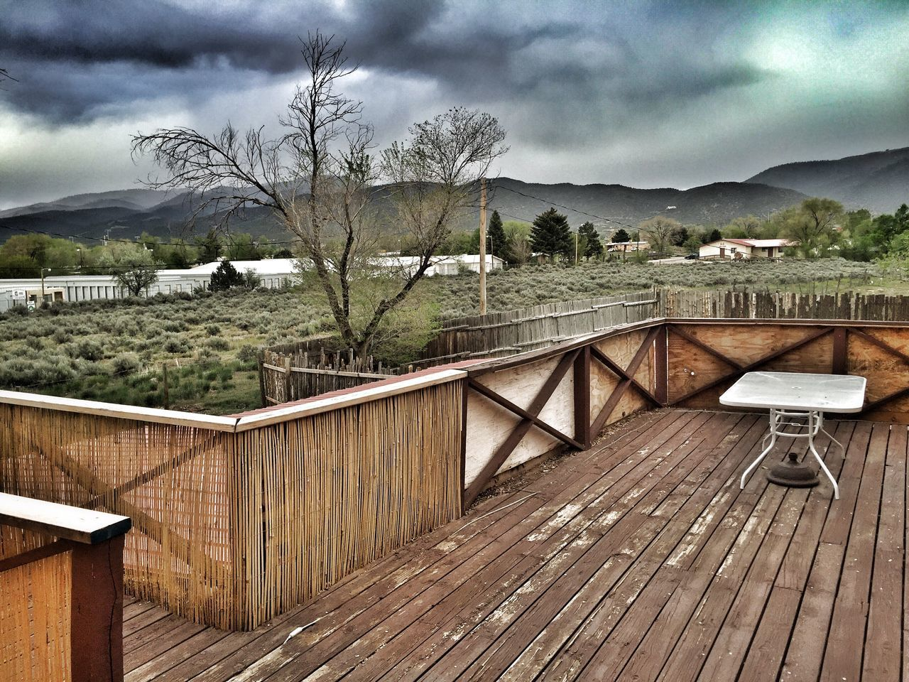 Rustic View Northern New Mexico Desert Beauty Mountains And Sky New Mexico, USA High Desert Back Yard Deck Decks Deck View Taos New Mexico Old Fence Old Fences Clouds Clouds And Sky Wood Deck Hello World Enjoying Life Taking Photos New Mexico Spring Storms Old Deck Relaxing