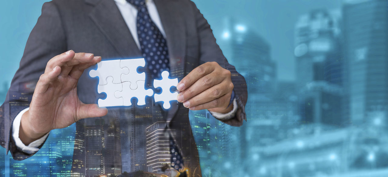 Business solutions, success and strategy concept. Businessman hand connecting jigsaw puzzle. Double exposure. Adult Business Business Finance And Industry Business Person Business Strategy Businessman Concept Conceptual Connecting Connection Corporate Business Growth Holding Jigsaw Puzzle Mature Adult Men One Man Only One Person People Solution Strategy Success Suit Well-dressed White Collar Worker