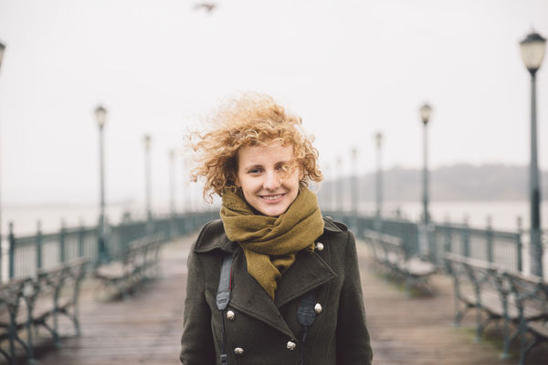 2017 Beautiful Woman Bridge - Man Made Structure Cold Temperature Curly Hair Day February Focus On Foreground Girl Jacket Looking At Camera One Person Outdoors Pier Pier Portrait Railing Real People River San Francisco Scarf Standing Waist Up Warm Clothing Winter Connected By Travel Shades Of Winter