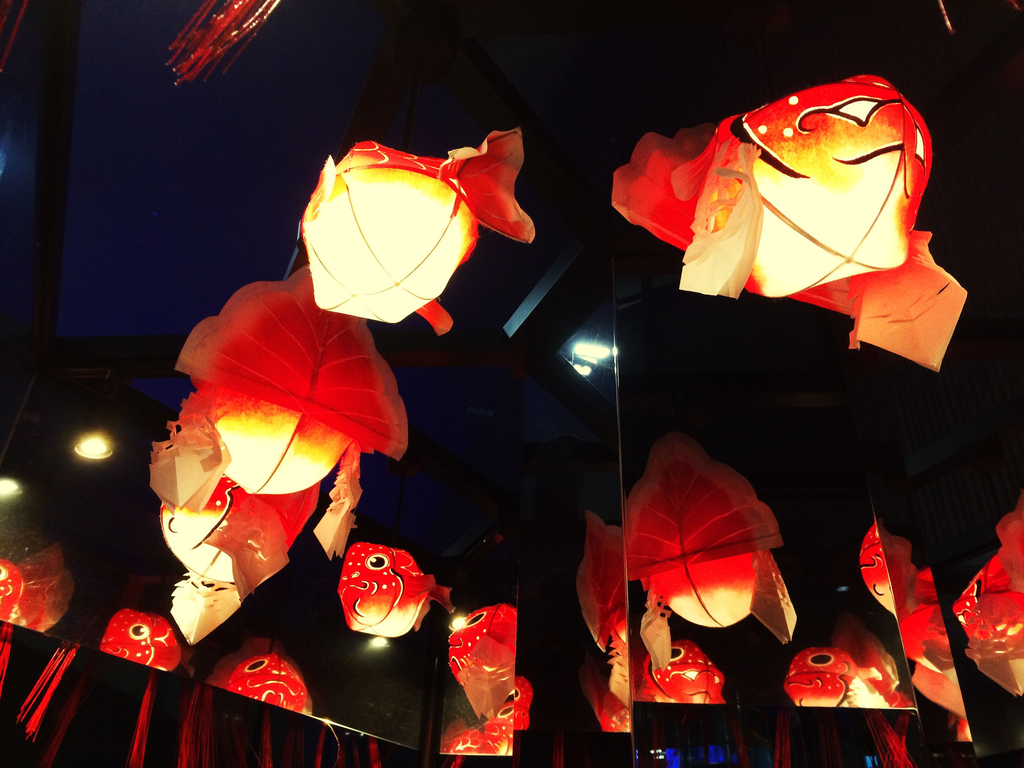 illuminated, decoration, indoors, hanging, lighting equipment, lantern, celebration, night, tradition, decor, low angle view, cultures, chinese lantern, red, electric lamp, traditional festival, electricity, christmas, ceiling, christmas decoration