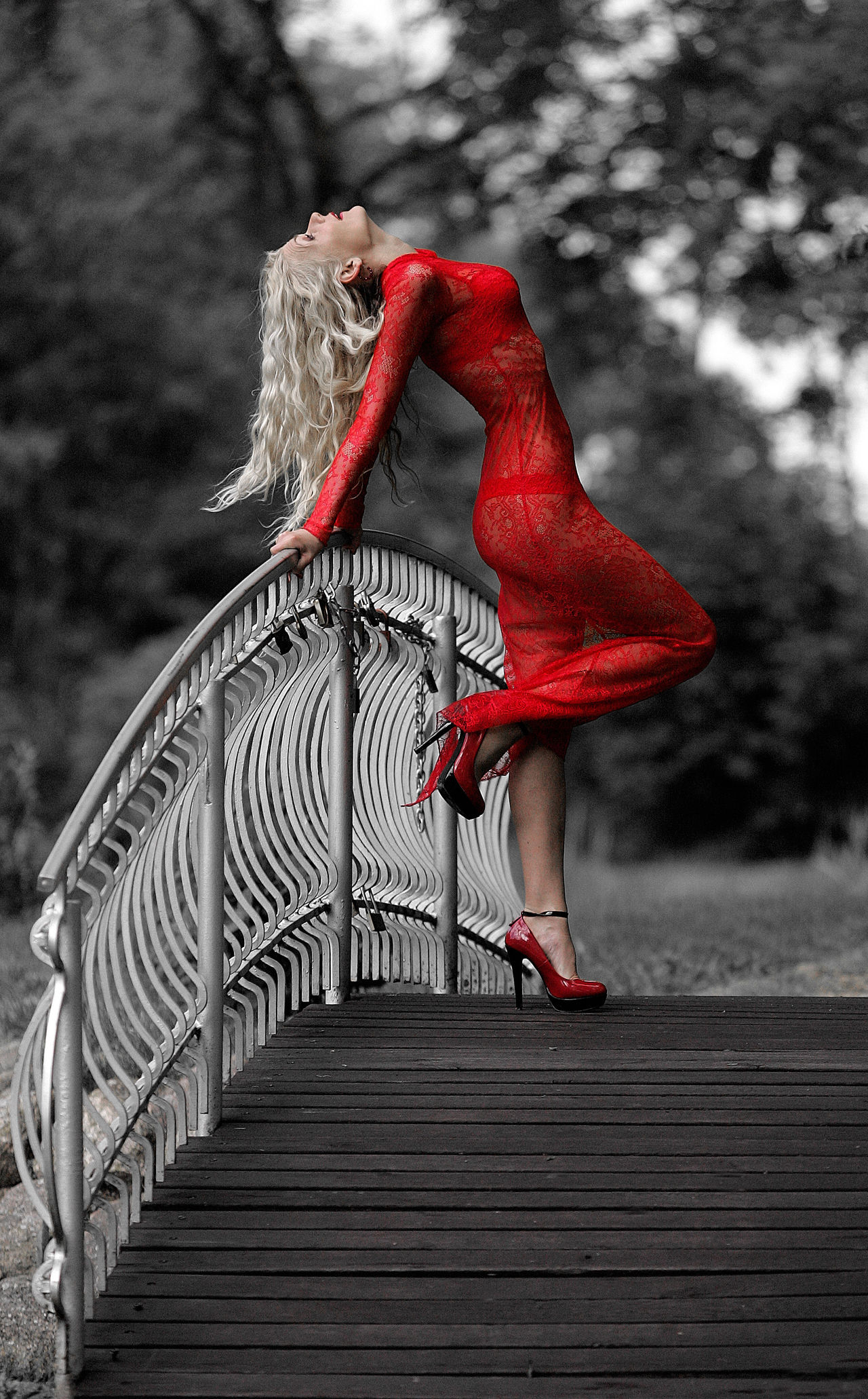 Adults Only Blond Hair Bridge - Man Made Structure Craze Day Ferry-bridge Flexibility Footbridge Full Length Grace Human Body Part Look One Person One Young Woman Only Only Women Outdoors People Red Red Dress Red Dress Fashion Show Red Dresses Vogue Women Young Adult Young Women
