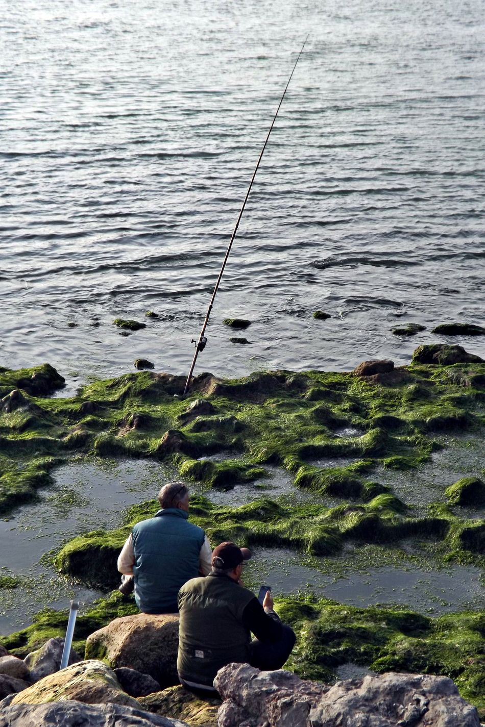 Beauty In Nature Day Fishing Fishing Equipment Fishing Pole Fishing Rod Fishing Tackle Full Length Horizon Over Water Leisure Activity Men Nature Outdoors People Real People Rippled Sea Sitting Standing Tranquil Scene Tranquility Two People Water Weekend Activities