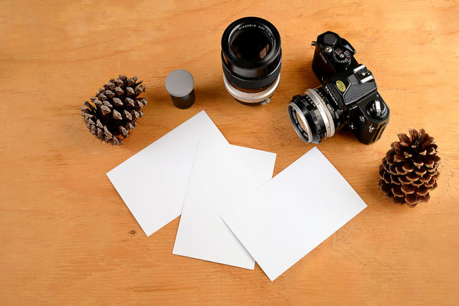 Arrangement Art Art And Craft Close-up Communication Craft Creativity Decoration Directly Above Finance High Angle View Human Representation Indoors  Nikon Camera No People Old Camera Old Camera Gear Paper Photo Paper Still Life Table Text Variation Wood - Material