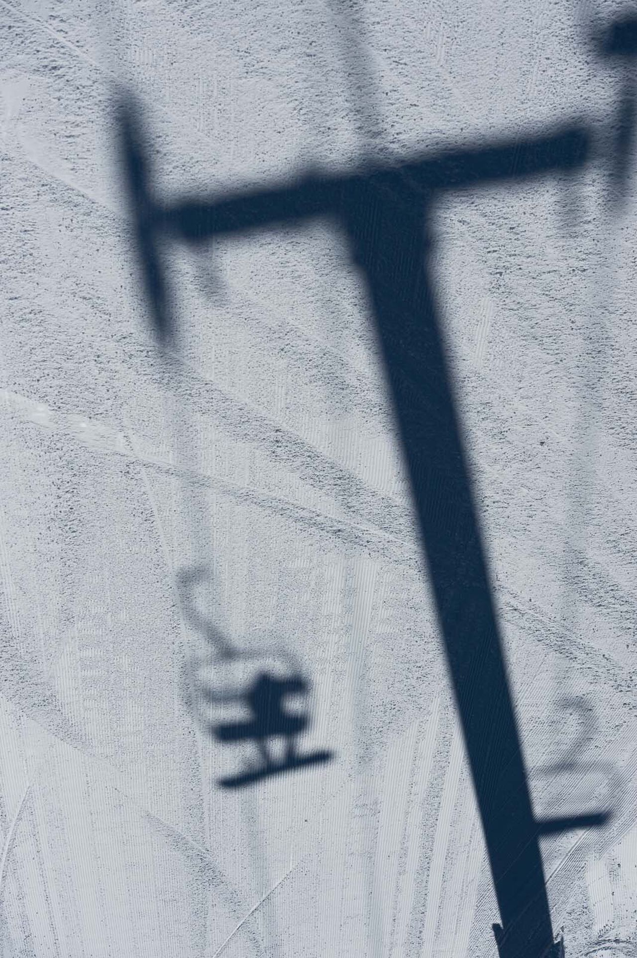 Riding the chairlft in Keystone Colorado > Using shadows against the snow on a sunny Winter day > Snowboarding Photography