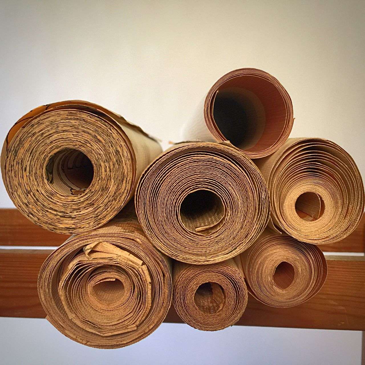 rolled up, roll, indoors, stack, no people, brown, day, close-up