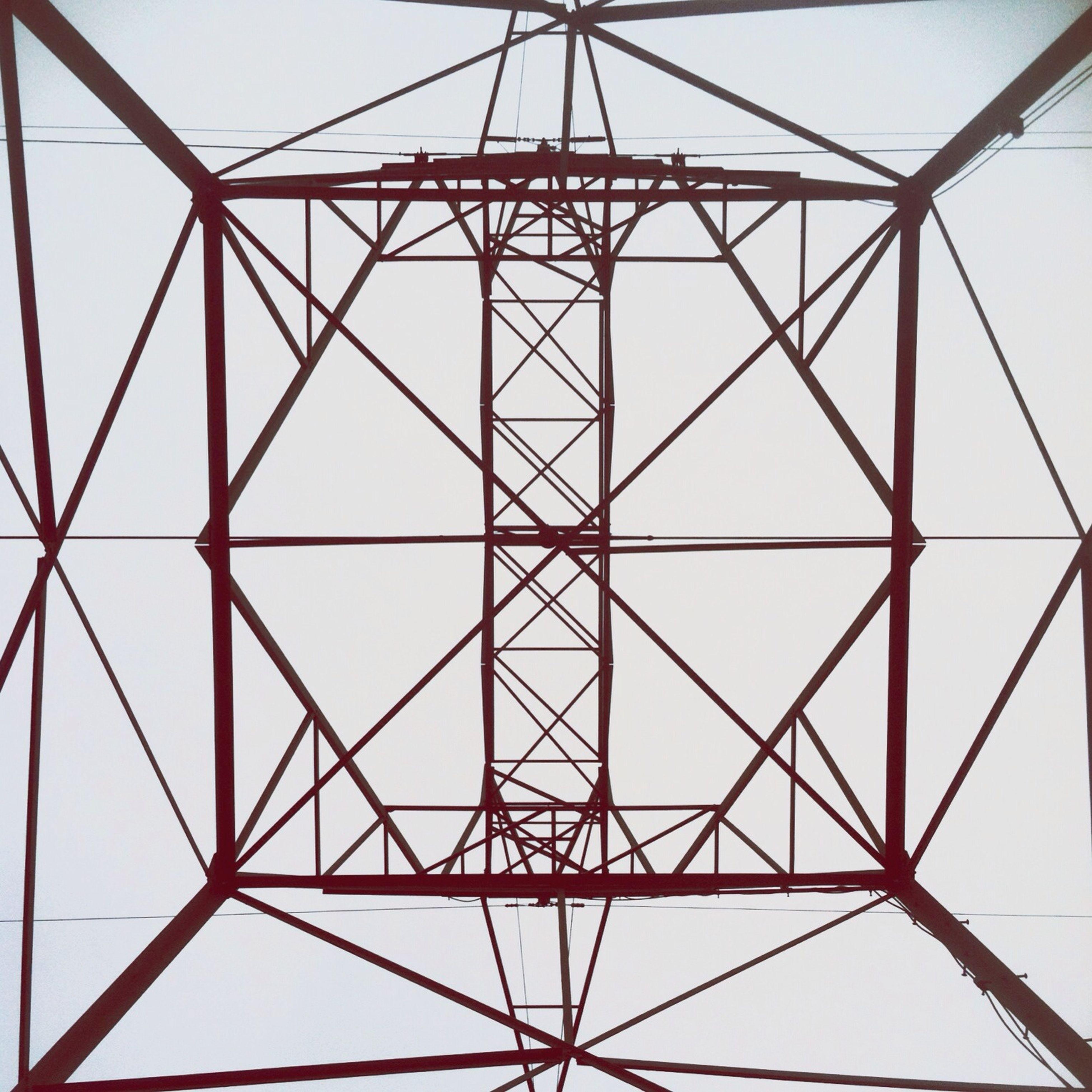 Directly Below Shot Of Metallic Tower Against Sky