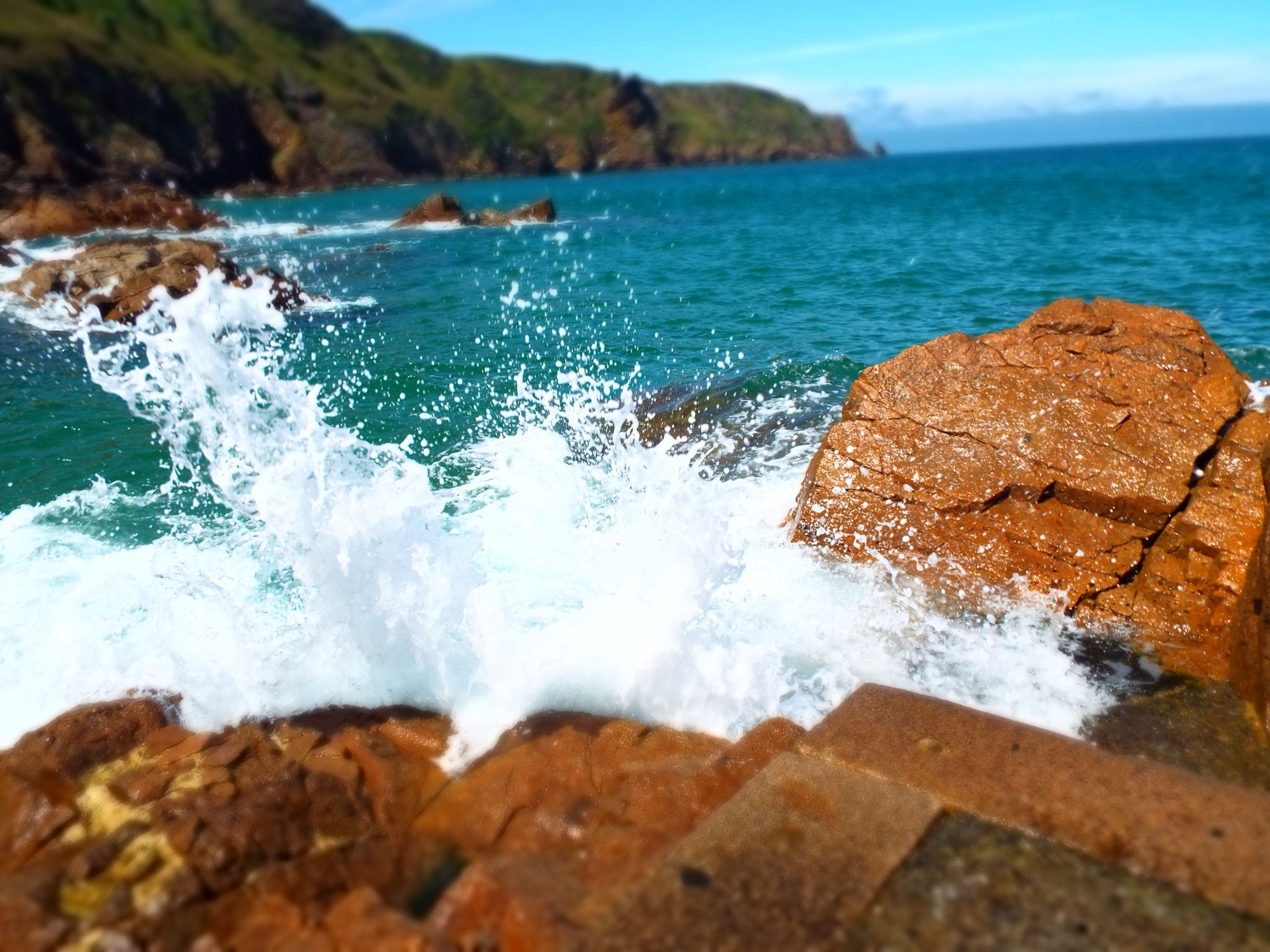 water, sea, surf, motion, wave, splashing, rock - object, scenics, beauty in nature, nature, horizon over water, blue, day, rock formation, sky, outdoors, no people, power in nature, idyllic, rock