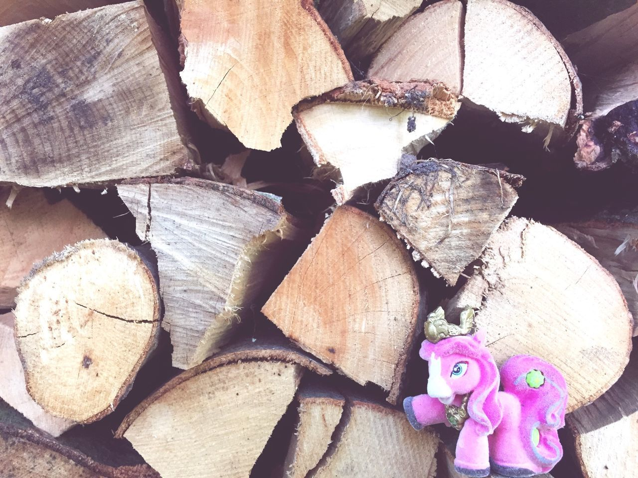 Pink Stuffed Toy Against Logs