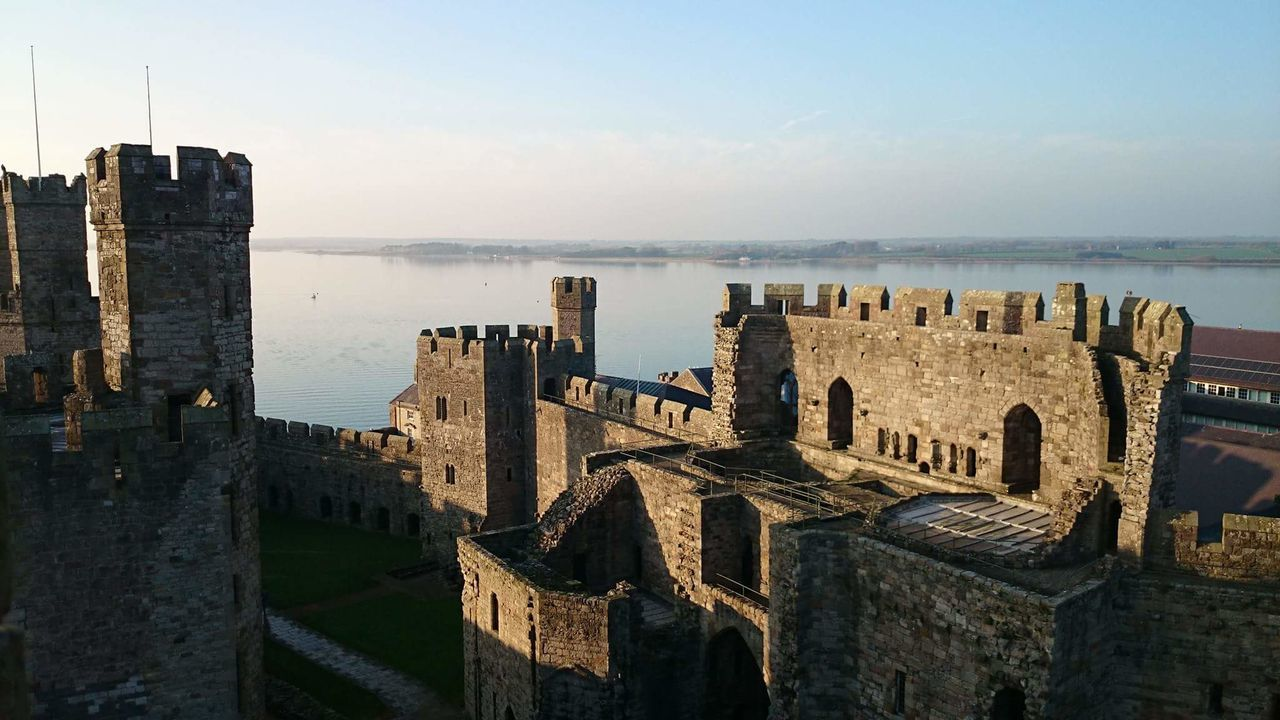 history, architecture, built structure, the past, building exterior, castle, old ruin, sky, ancient, sea, fort, no people, outdoors, day, travel destinations, water, horizon over water, nature, ancient civilization, cityscape