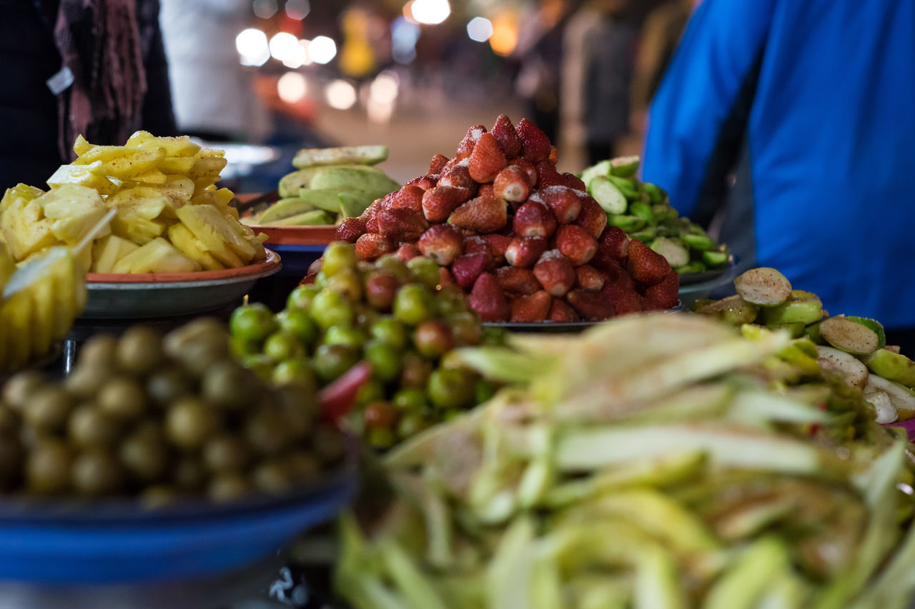 Asia, Vietnam, Travel Abundance Bowl Close-up Food Food And Drink Freshness Fruit Fruits Healthy Eating Indulgence Leaf Market No People Organic People Red Ripe Still Life Strawberry Table Temptation Variation Vietnam