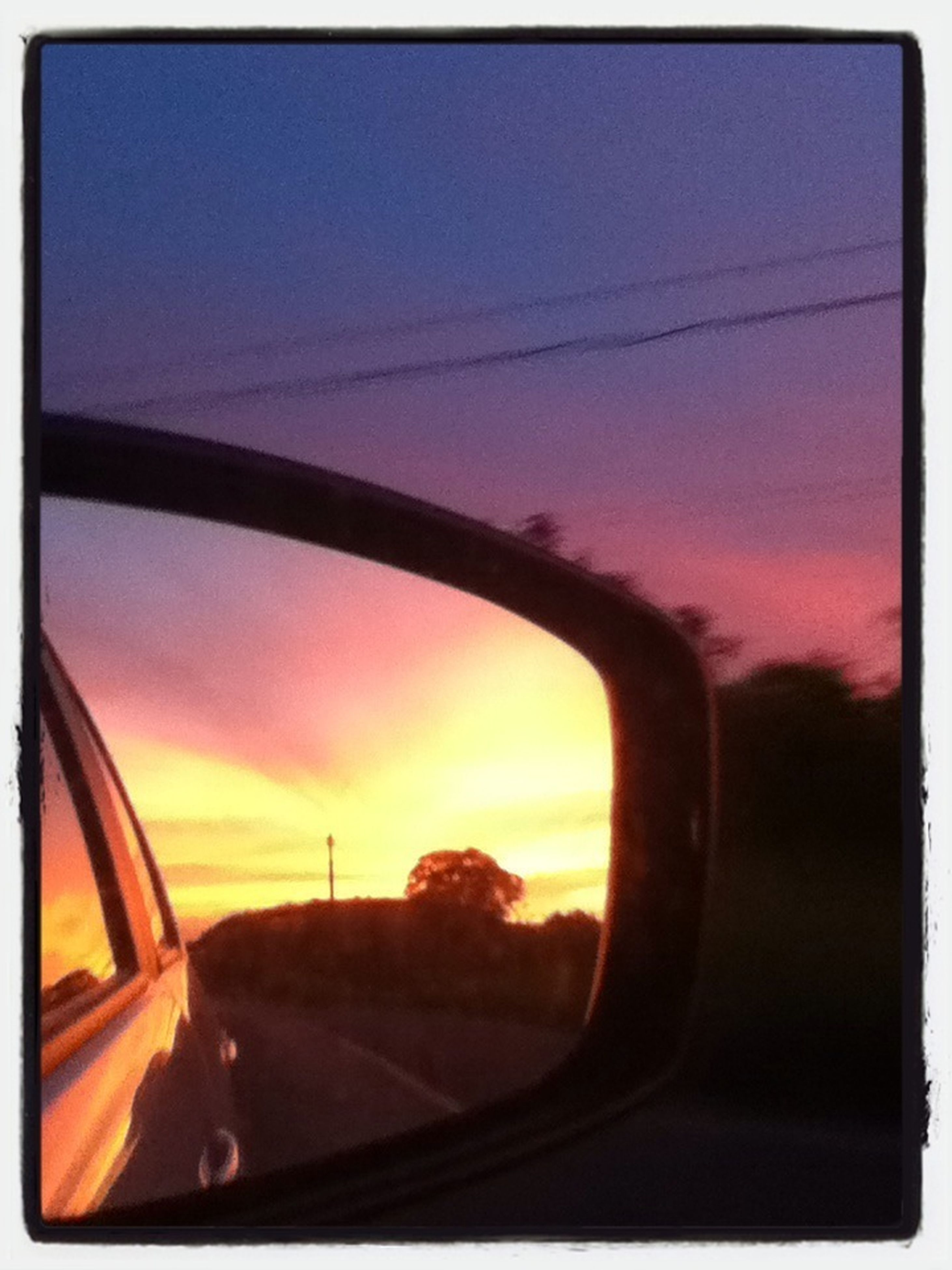 transportation, sunset, mode of transport, sky, vehicle interior, car, land vehicle, glass - material, transparent, side-view mirror, transfer print, orange color, reflection, auto post production filter, window, cloud - sky, travel, car interior, windshield, part of