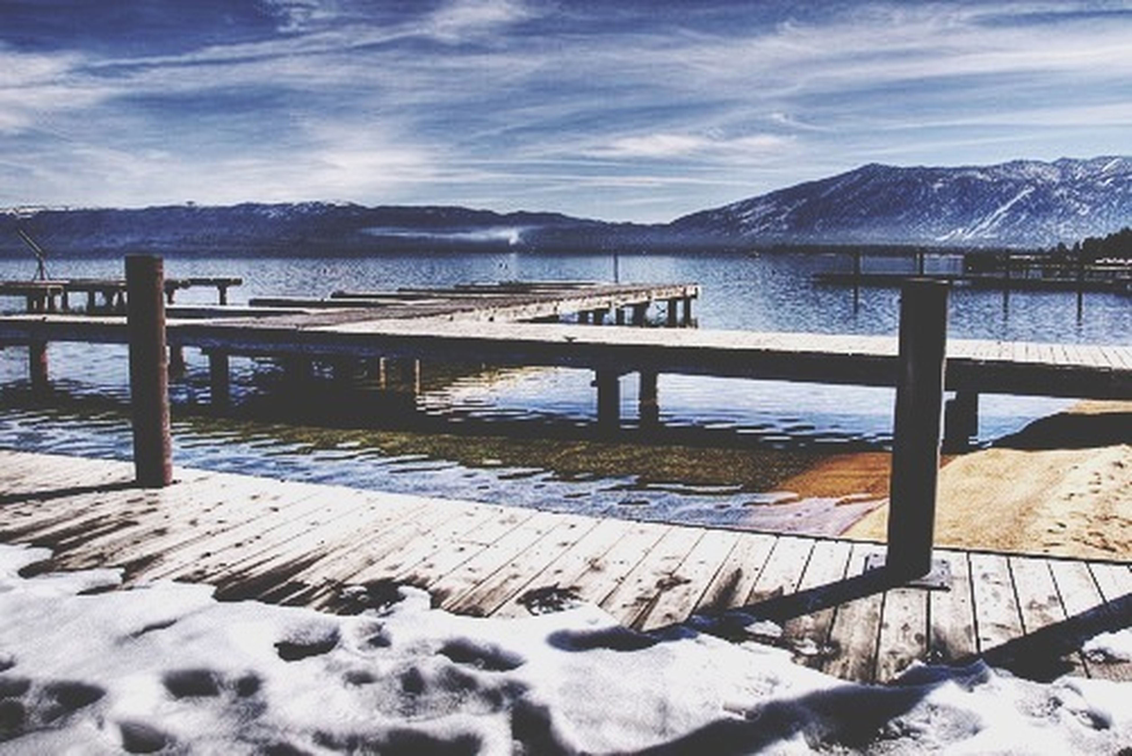 snow, winter, cold temperature, mountain, season, tranquil scene, weather, tranquility, scenics, mountain range, beauty in nature, frozen, sky, water, nature, lake, covering, wood - material, snowcapped mountain, white color