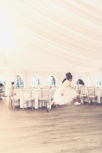 Dance Like Nobody Is Watching Freedom Be Free Jump Dancing Girl Happiness Leaping Pink Marquee Celebrate ExpressYourself Youth Moves Weddings Around The World Scotland Gillian McBain Photographer Wedding Guest Tables Chairs Settings