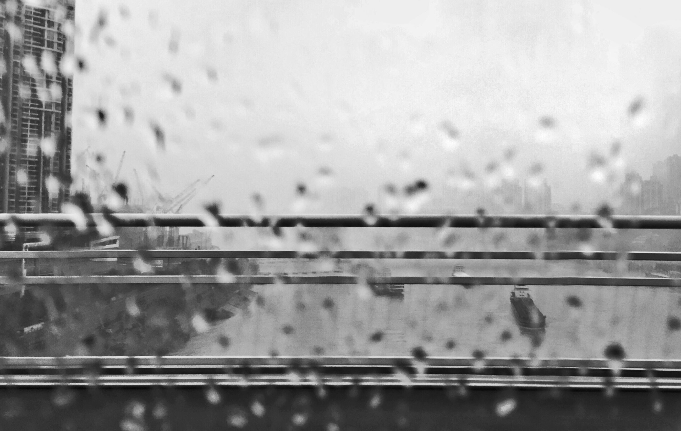 window, water, drop, focus on foreground, glass - material, transparent, wet, rain, indoors, railing, close-up, built structure, building exterior, architecture, metal, glass, full frame, day, backgrounds, reflection