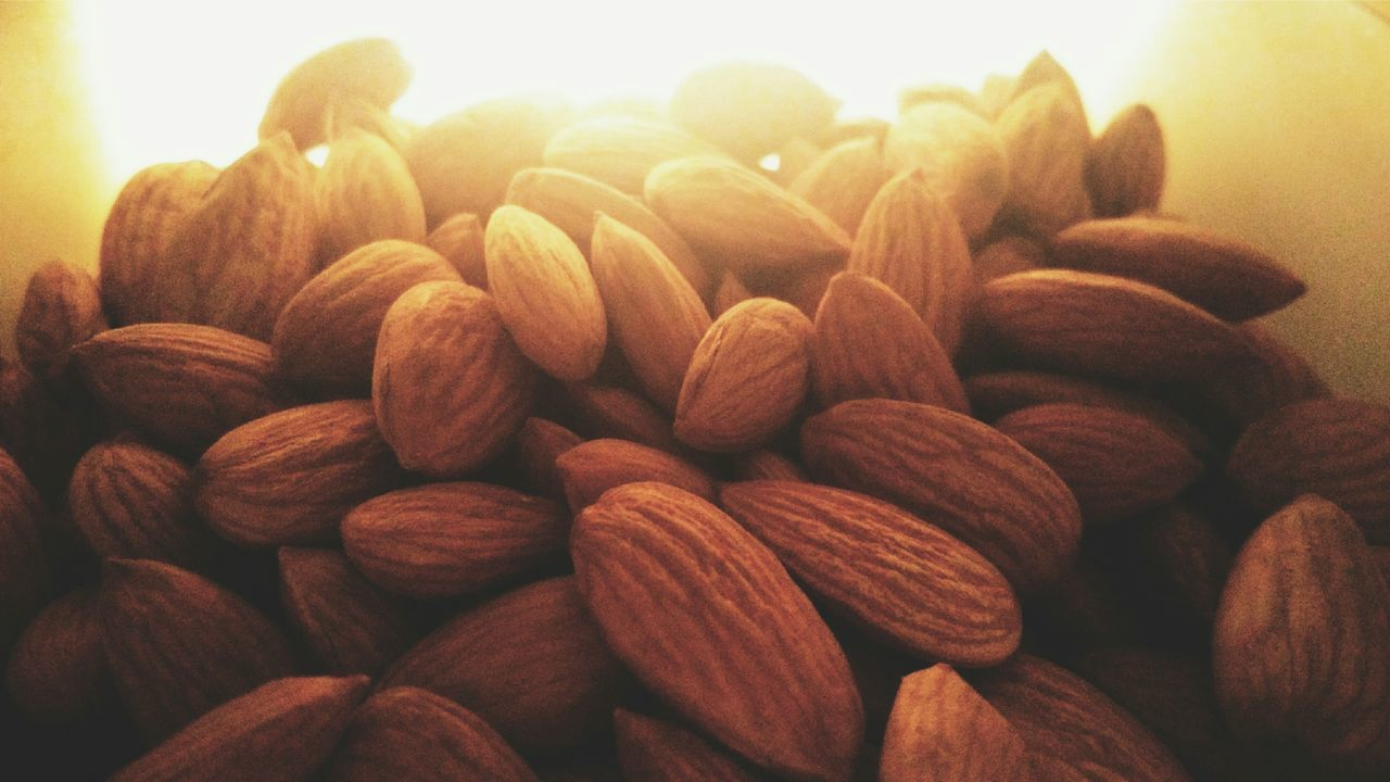 Life is like almonds. They taste better with chocolates. Almonds Lifequotes WhatIValue Lightandcolourful Light And Shadow Foodporn What I Value Bestoftheday Taking Pictures PhonePhotography From My Point Of View Showcase: January Check This Out EyeEm Gallery Minimalism Eye4photography  EyeEm Best Shots Photography Life Is Beautiful Eating Healthy Inside The Refrigerator Eat Dryfruits Perspective Photooftheday