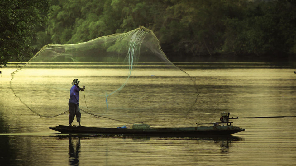 Fisherman at river Adults Only Commercial Fishing Net Fisherman Fishing Fishing Net Freshwater Fishing Horizontal Nature Net Fishing One Person River Silhouette Thailand Wisdom