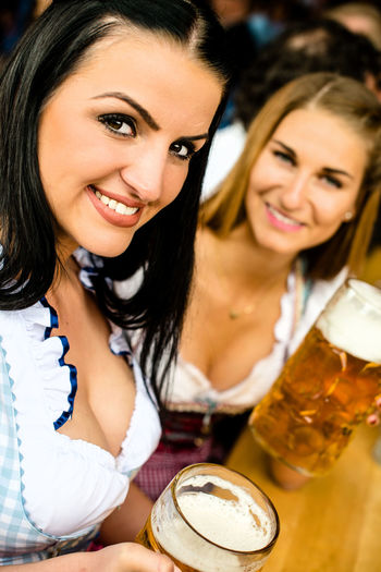 Young woman havig fun on the Oktoberfest in Munich Alcohol Attractive Beer Beer Festival Brezel Dirndl Event Fun Lifestyles Munich München Oktoberfest Party Partying Tracht Trachten Woman Woman Portrait Women Young Women