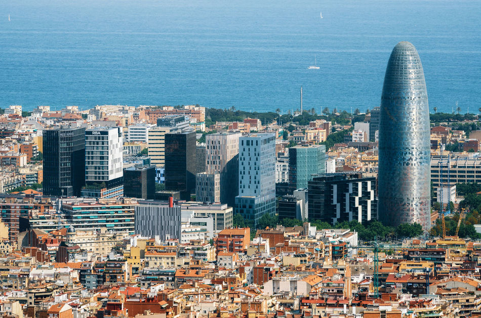 Scenic aerial cityscape with the Agbar Tower and skyscrapers in Barcelona in Spain Aerial View Architecture Barcelona Barcelona, Spain Building Exterior City Cityscape Day Outdoors Sea Skyscraper Travel Destinations Urban Skyline View From Above
