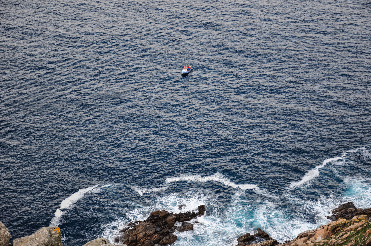 Little boat at the atlantic coast in northern Spain. Beauty In Nature Blue Water Boat Calm Sea Day Fisherman Boat Fisterra Little Boat Nature Nautical Vessel Ocean Outdoors Scenics Sea SPAIN Water Waves Waves, Ocean, Nature
