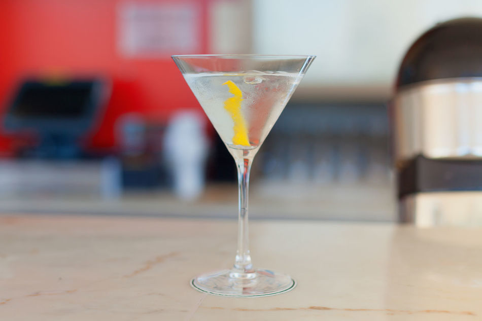 Alcohol Alcoholic  Background Bar Beverage Chilled Classic Close-up Cocktail Drink Drinking Glass Freshness Garnish Happy Hour Ingredients Lemon Peel Martini Martini Glass Mixed No People Party Rind Served Strong Twist