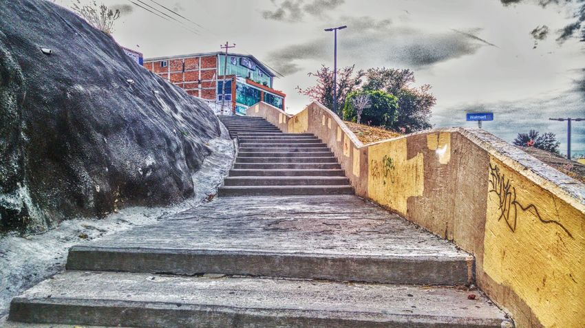 Hacia arriba The Way Forward Steps And Staircases Built Structure Architecture Multi Colored Outdoors Stairs Sky One Person Staircase Building Exterior Urbanexploration Picsofday Walking Around Fullcolor RAWphotography Day City Street Urbanphotography Illuminated Cityscapes Taking Photos