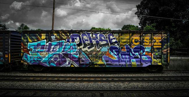 Graffiti covered train car in Ayer, MA @natesteelephotography Train Train Car Graffiti Graffiti Art Urban Transportation Art ArtWork Ayer Massachusetts New England  Commuting Commuter Railway The T Mbta Tracks Nikkor D7100 Vingette Beautiful Detail Contrast Nikon Nikonphotography