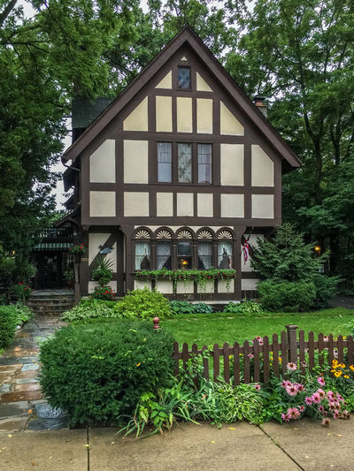 Quaint cottage Architecture Bed And Breakfast Inn Building Exterior Cottage Flower Garden Front Or Back Yard House No People Picket Fence Quaint House