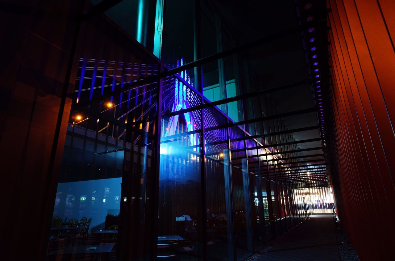 Low Angle View Of Illuminated Walkway At Night
