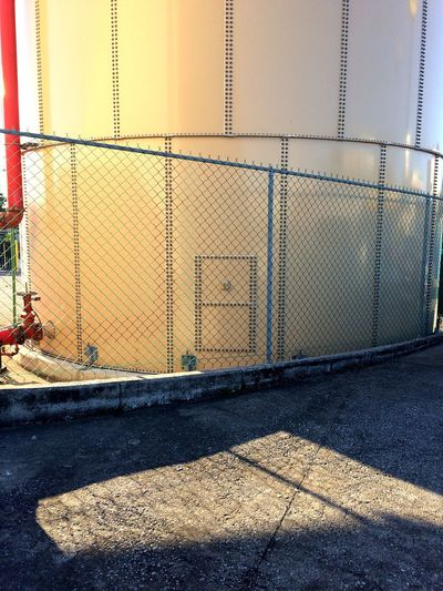 Day Fence Safety Chainlink Fence No People Metal Architecture Built Structure Water Passing By Streetphotography Street Concrete City Parking Lot