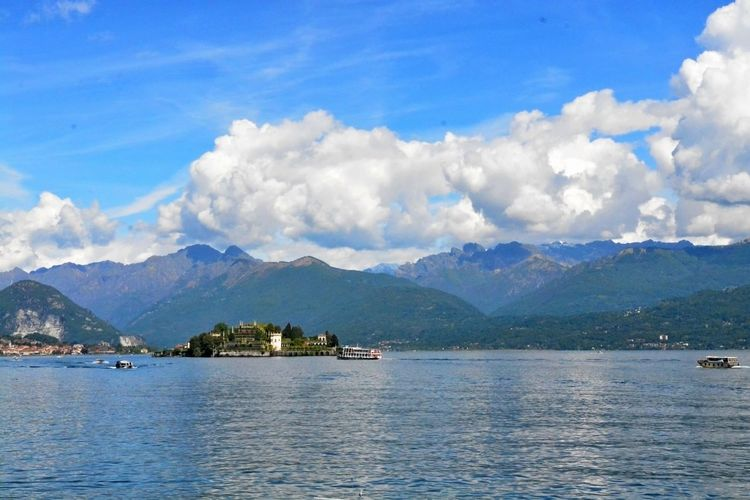 Stresa Italy Architecture Beauty In Nature Blue Building Exterior Built Structure Cloud - Sky Day Lake Mountain Mountain Range Nature No People Outdoors Range Scenics Sky Tranquil Scene Tranquility View Into Land Water Waterfront