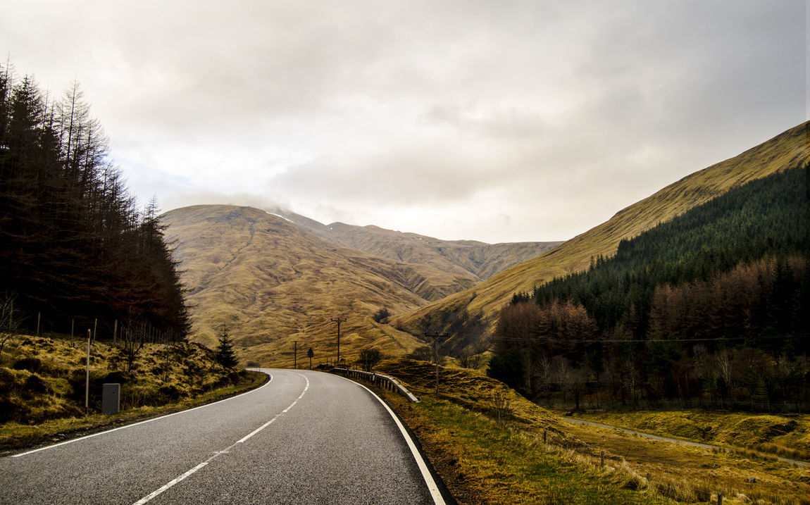 Beauty In Nature Cloud Cloud - Sky Cloudy Country Road Countryside Day Diminishing Perspective Empty Road Glencoe Highlands Landscape Mountain Mountain Range Nature Non-urban Scene Rain Road Road Marking Scotland Sky The Way Forward Traveling Tree Vanishing Point