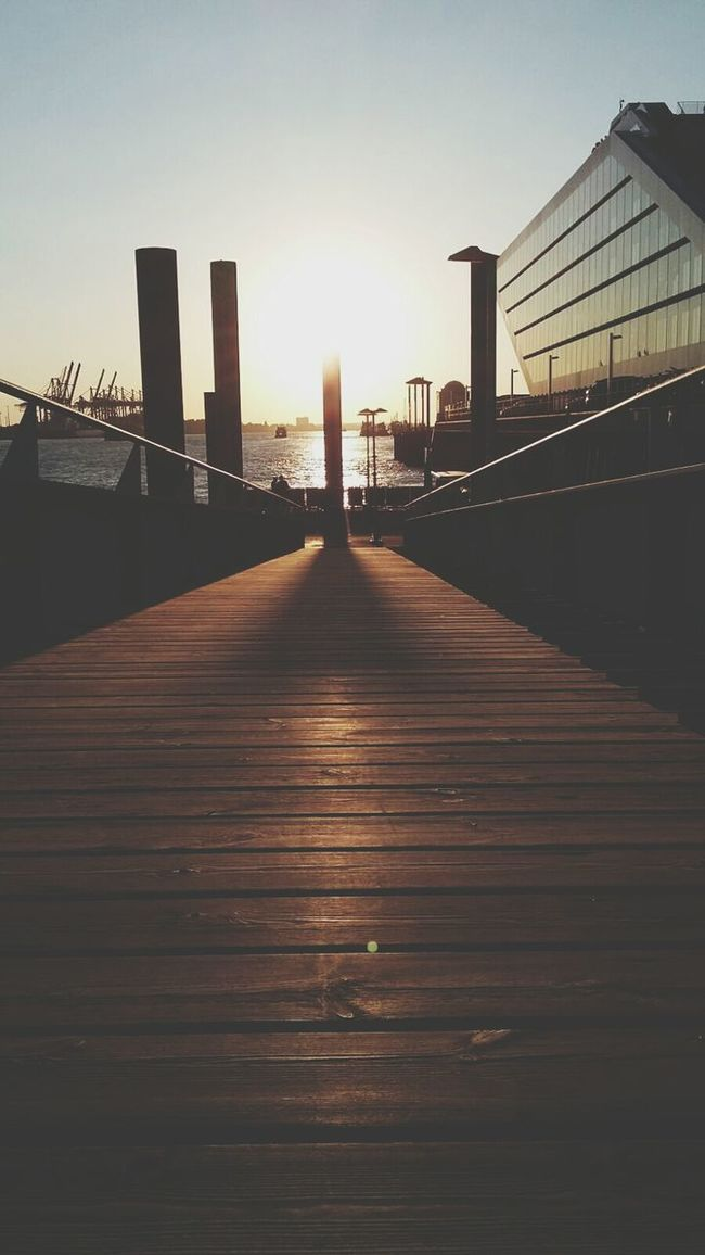 Built Structure Architecture Sunset Wood - Material The Way Forward Building Exterior Boardwalk City Surface Level Railing Water Pier Wooden Wood Paneling Outdoors Sky Narrow Tall Sun Tranquility Life Eyemphotography Transportation Harbour Life Illuminated